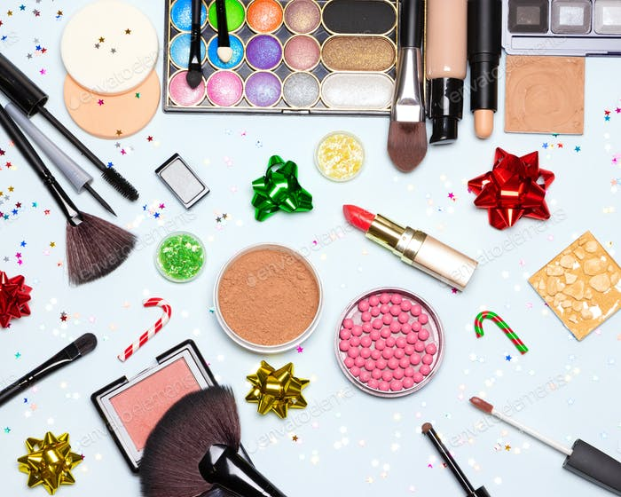 Christmas and New Year party bright glistening makeup flat lay