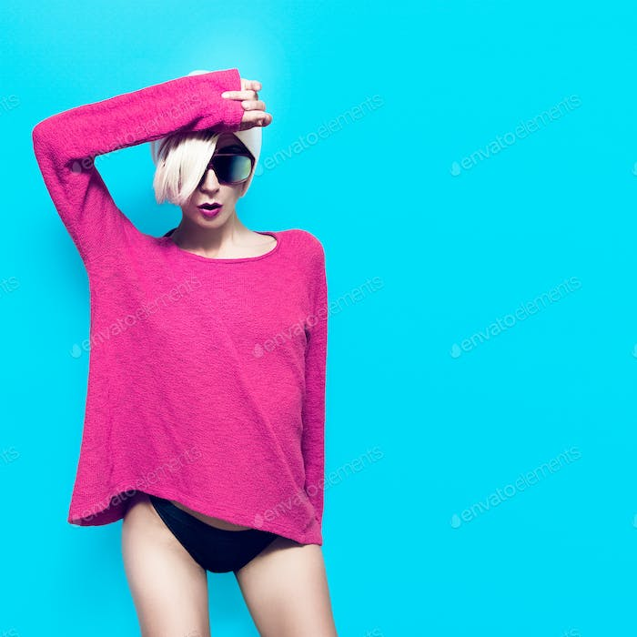 Sexy slim blonde girl on blue background. Party fashion style