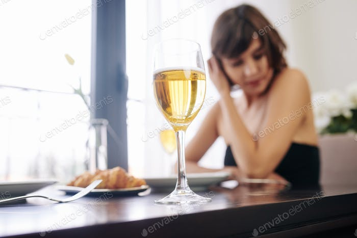Woman waiting for date in restaurant