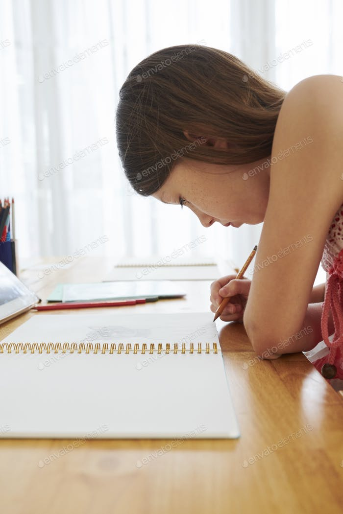Schoolgirl concentrated on drawing