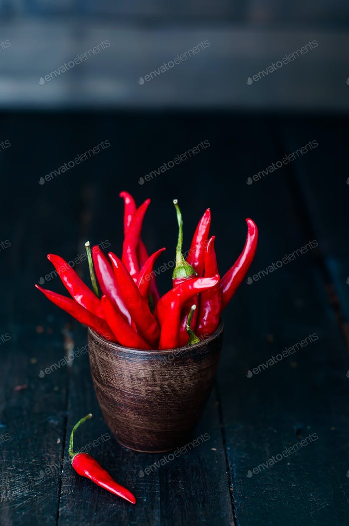 bouquet of red hot chili peppers in old cup
