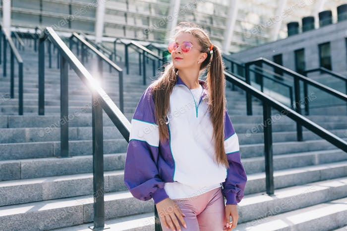 Modern woman dressed oldschool jacket and fashionable glasses