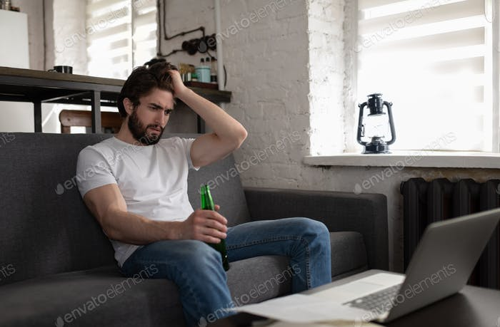 Stressed man trying to find job online