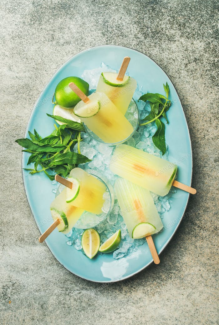 Summer refreshing lemonade popsicles with lime and mint on plate