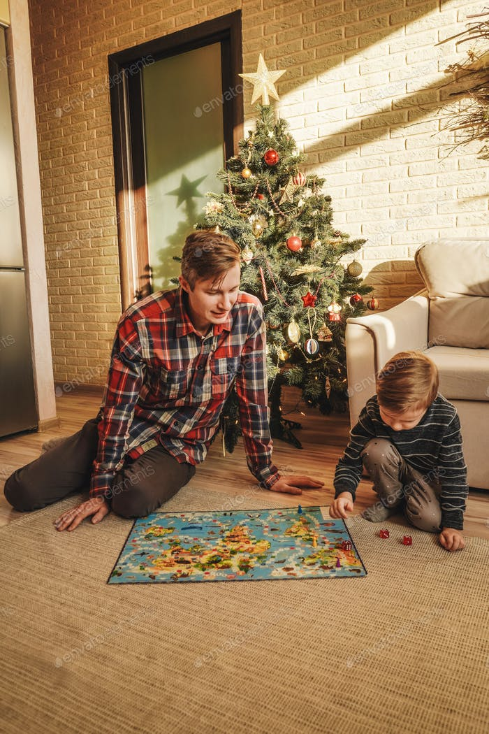 Happy family playing board game walker