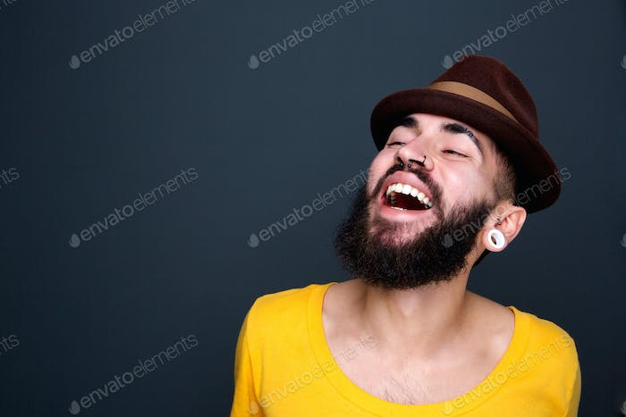 Man with beard and hat laughing