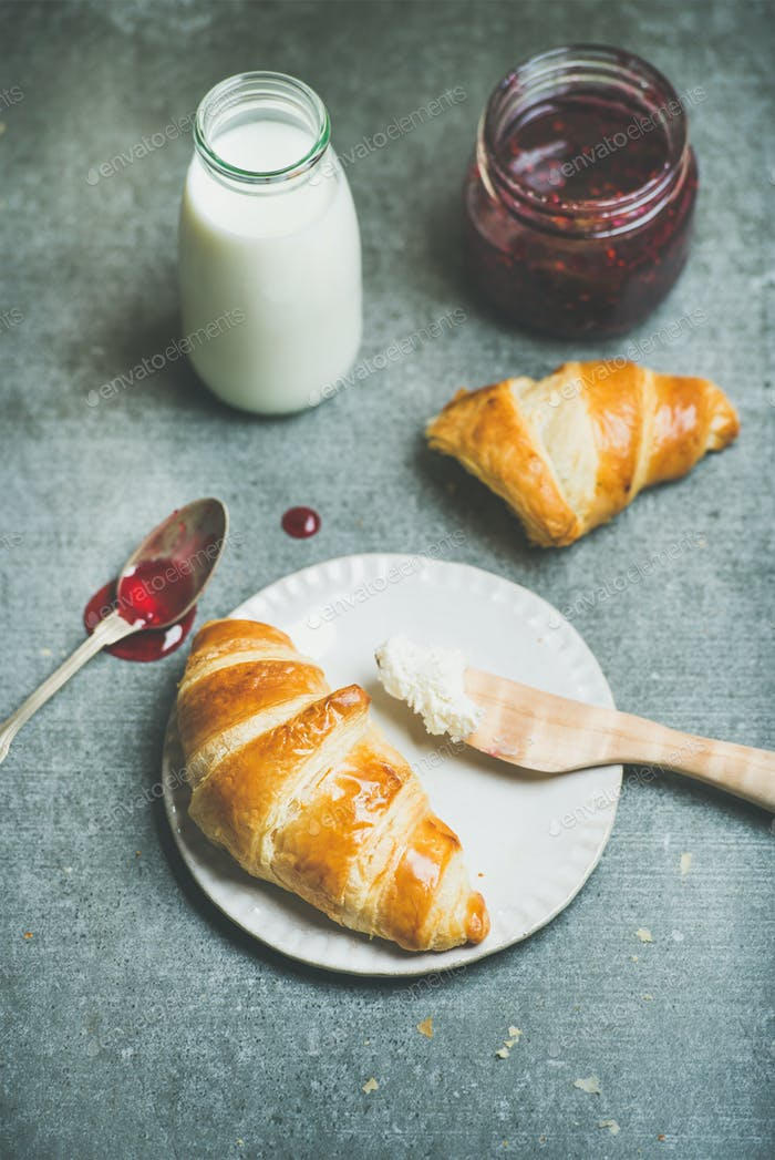 Croissants with raspberry jam, ricotta cheese and milk