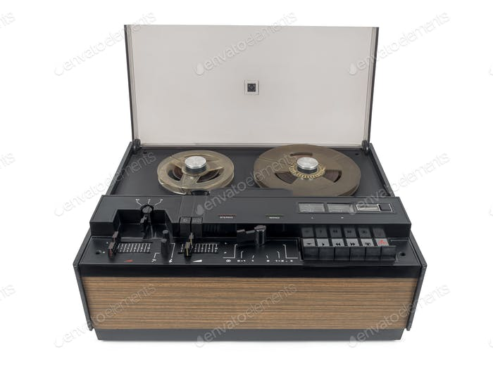 Old audio tape racorder on white background