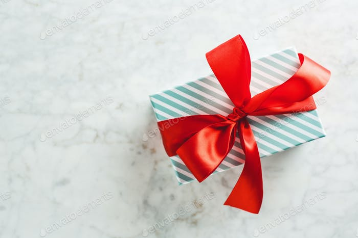 Modern wrapped gift on bright table