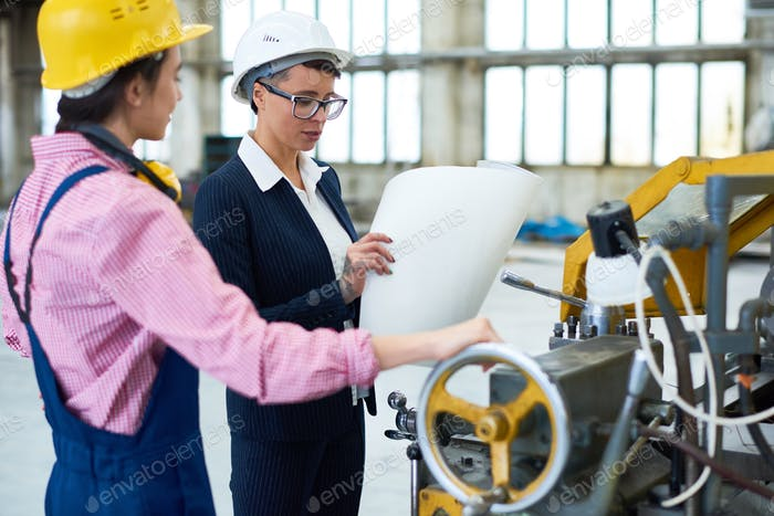 Portrait of Two Female Engineers at Plant