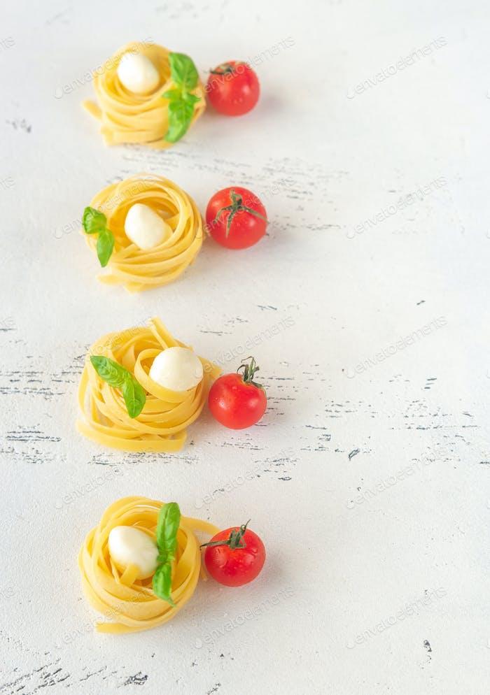 Raw fettuccine pasta