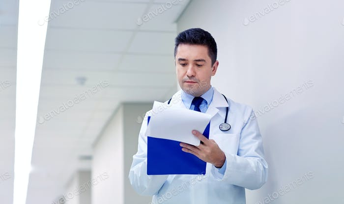 doctor with clipboard at hospital corridor