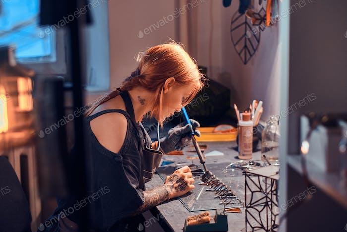 Talanted designer is working at glass workshop