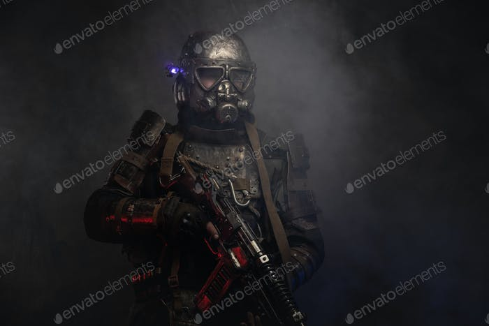 Cyborg with weapon in mist and smoke