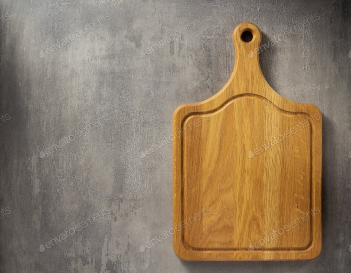 cutting board at grey stone table