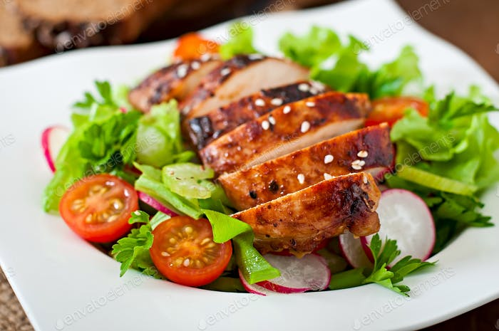 Fresh vegetable salad with grilled chicken fillet