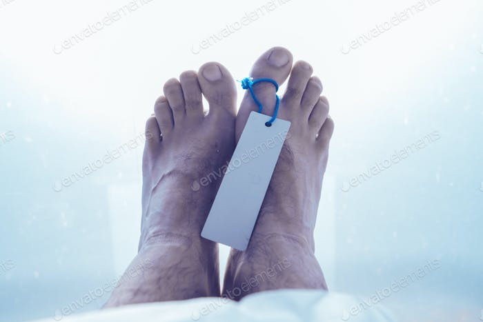Feet of dead male person in morgue
