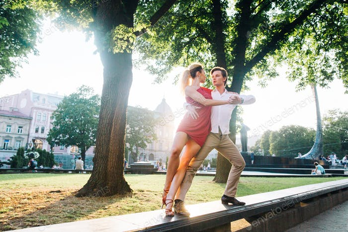Passionate hipster couple dancing in the streets, summer honeymoon of dancers