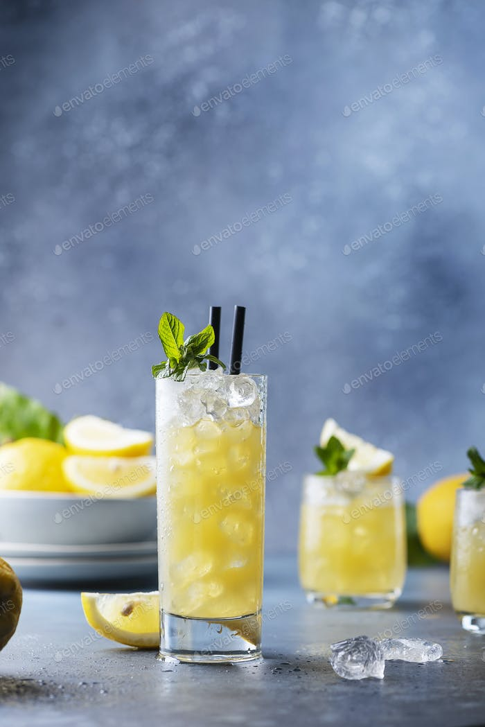 Fresh summer cocktail with lemons