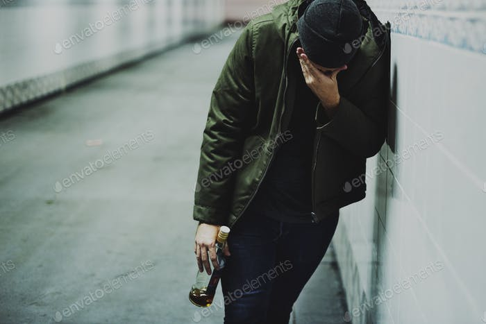 Homeless Alcoholism Man Holding Liquor Bottle Feeling Depressed