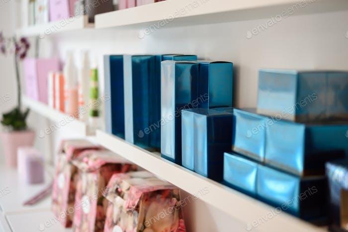 Cosmetic section with facial cream in beauty salon