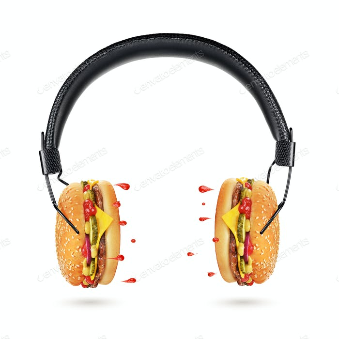 Tasty and juicy hamburger concept. Headphones with burgers.