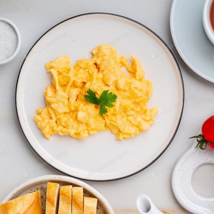 Scrambled eggs, Omelette. Breakfast with pan-fried eggs