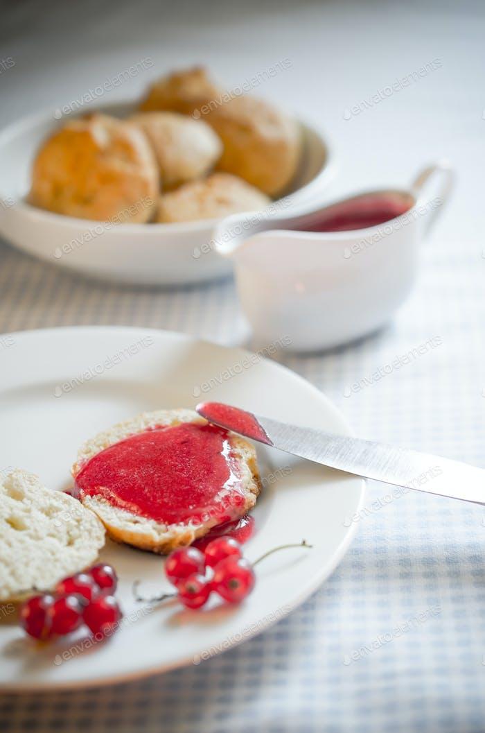 scone with redcurrant jam
