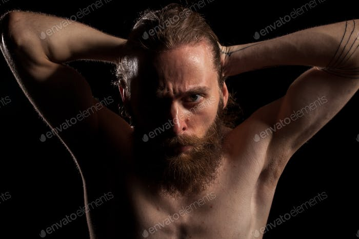 Hipster with long beard on black background