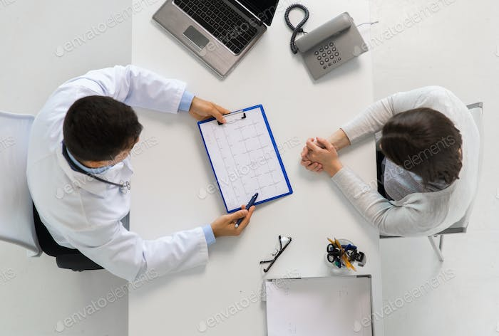 doctor with cardiogram and patient at hospital