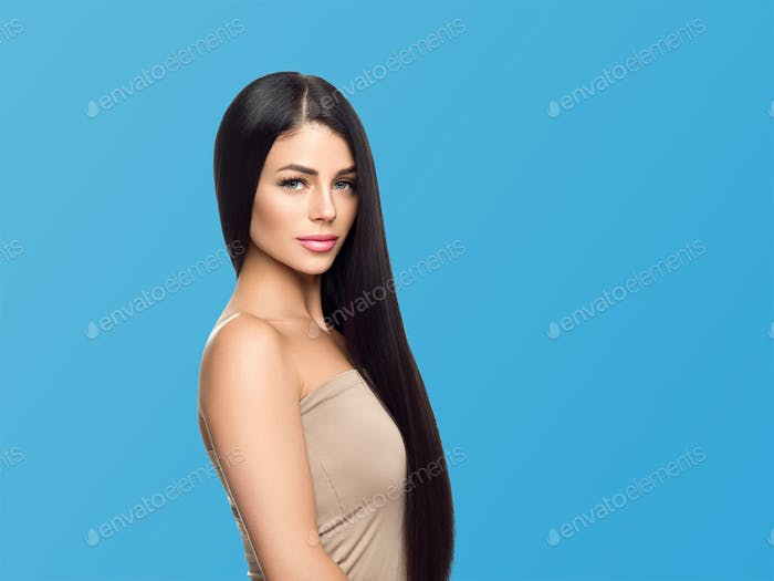 Woman cosmetic closeup beauty portrait healthy care skin and hair over blue color background