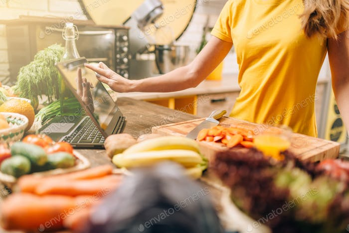 Female person cooking on the kitchen, healthy food