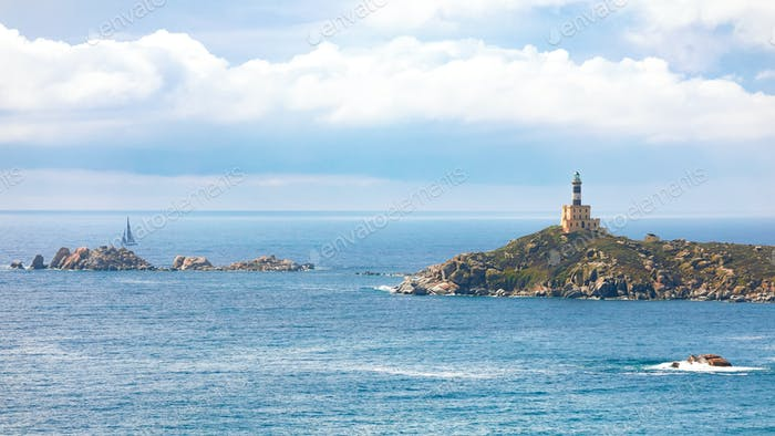 Fantastic view of Capo Carbonara lighthouse with turquoise water.