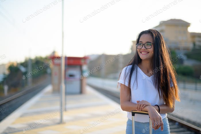 Young Happy Asian Tourist Woman Waiting At The Train Station