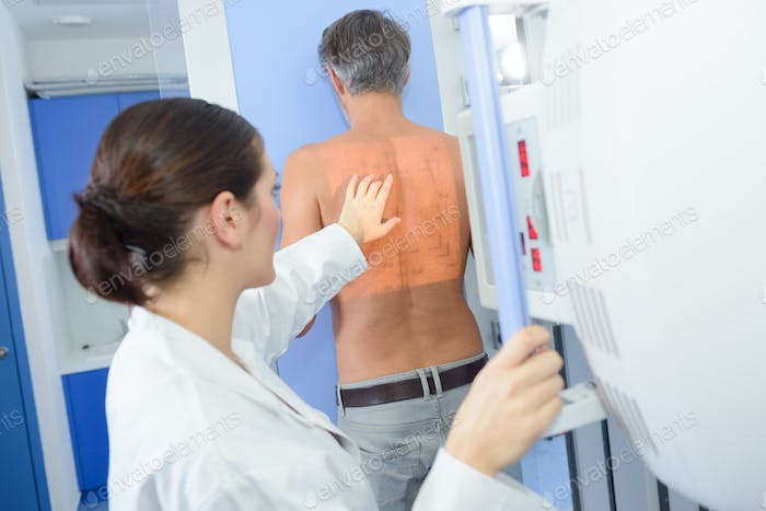Nurse preparing patient for scan