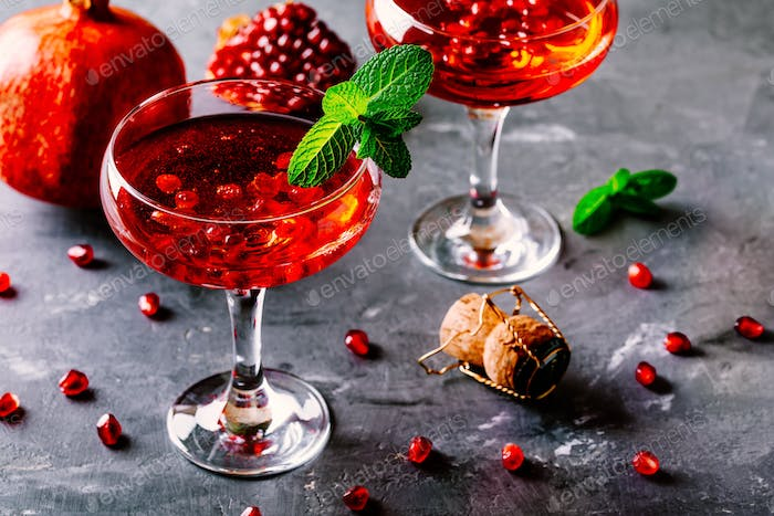 red cocktail with sparkling wine and pomegranate seeds