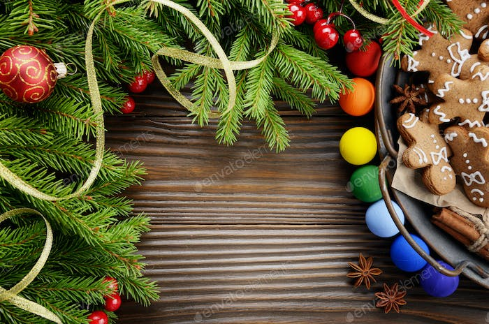 Flat lay Christmas background of spruce branches and tray with g