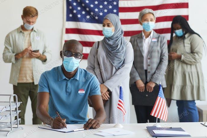 People Wearing Masks at Voting Station