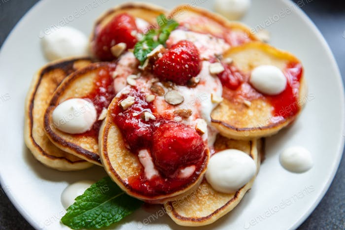 Pancakes with yogurt and strawberry jam