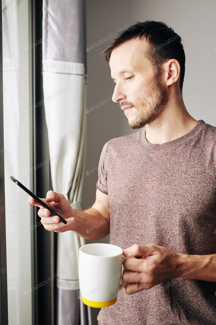 Man checking text messages