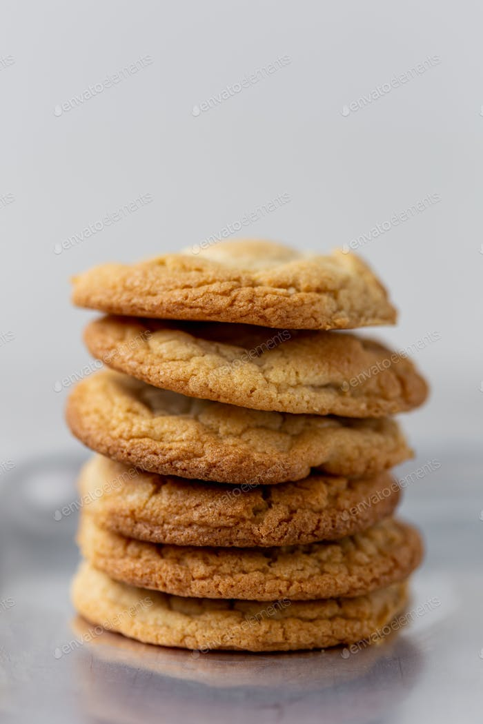 Stack of homemade cookies against gray background