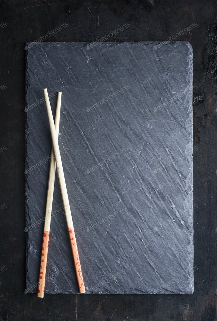 Sushi black slate and chopsticks