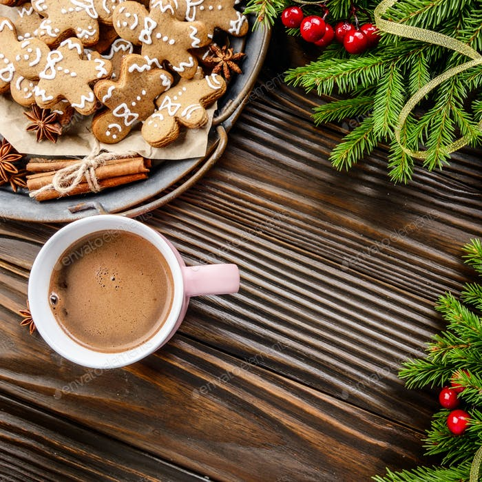 Flat lay Christmas background of pink mug with hot chocolate, sp