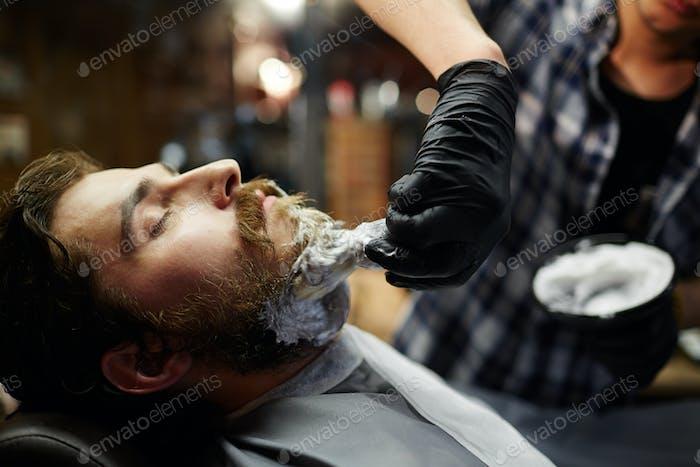 Man in shaving salon
