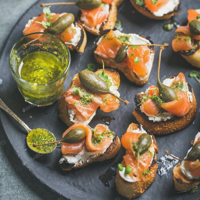 Close-up of salmon crostini with homemade pesto sauce