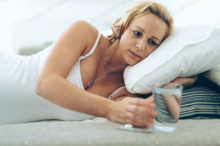 Picture of pregnant woman taking medication pills