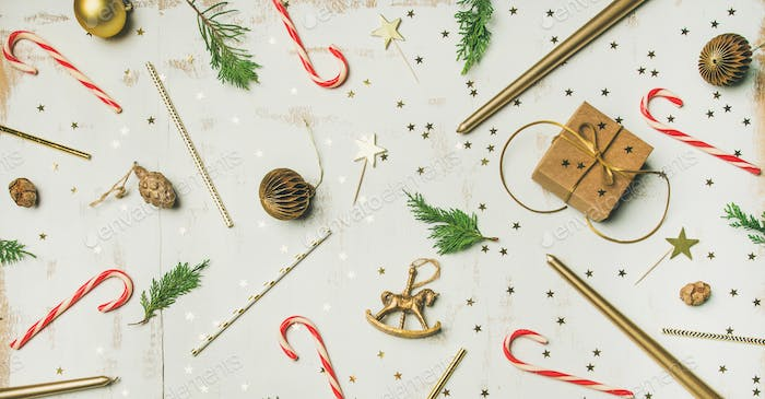 Flat-lay pattern of holiday decoration objects, toys, candles, box