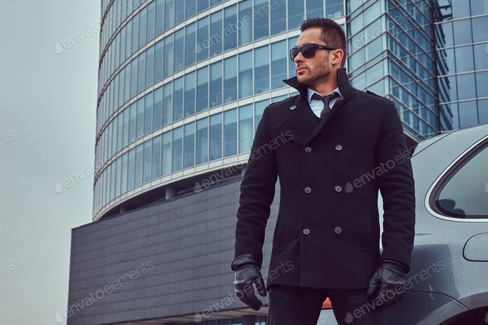 Portrait of a bodyguard in a stylish suit.