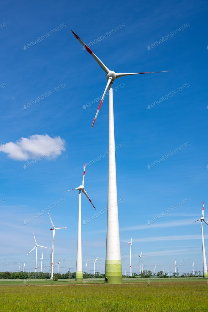 Wind turbines in front of a blue sky