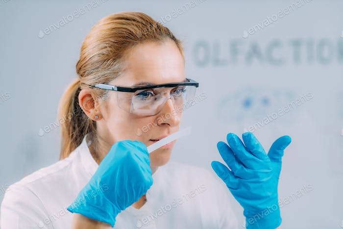 Olfaction. Female Scientists Examining Smells.